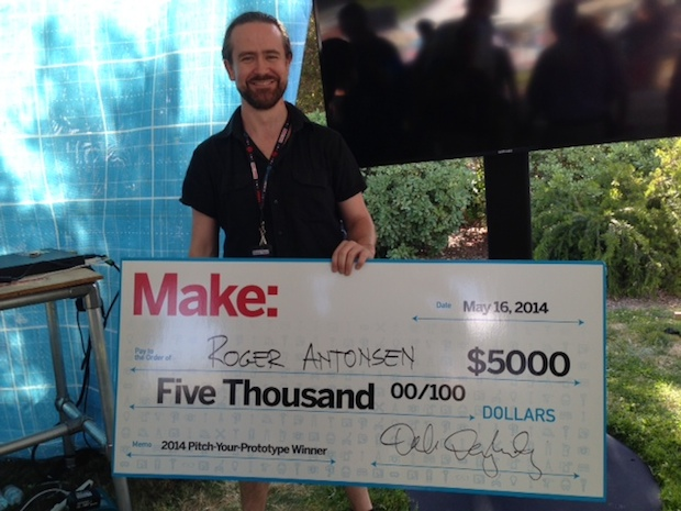 Pitch Your Prototype winner Roger Antonsen with his $5000 check