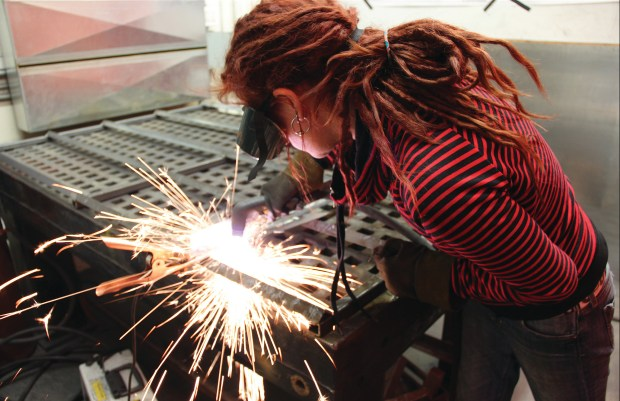 Using the plasma cutter at the Artisan's Asylum makerspace in Somerville, Massachusetts