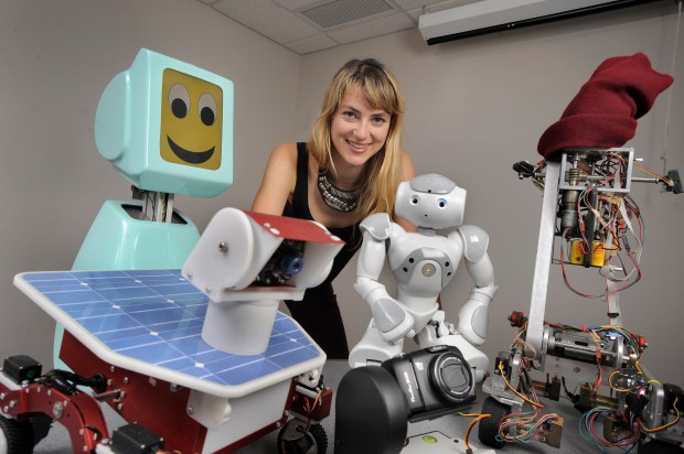 Heather Knight as a student with robots from the Carnegie Mellon robot census.
