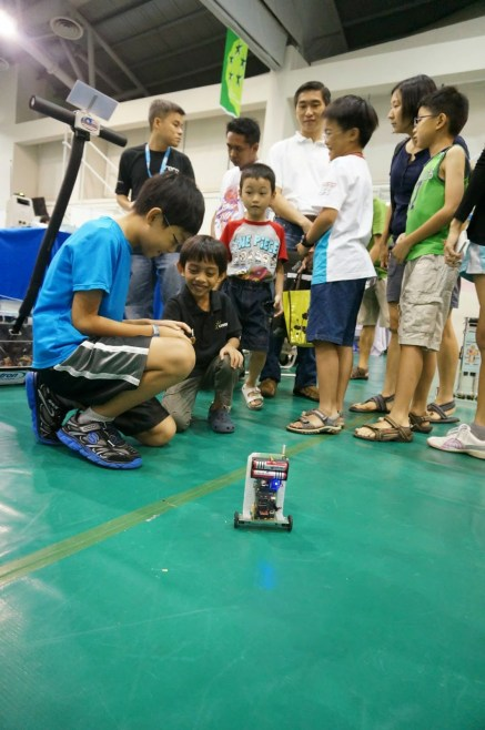 Kids are trying out with the self-balancing robot.