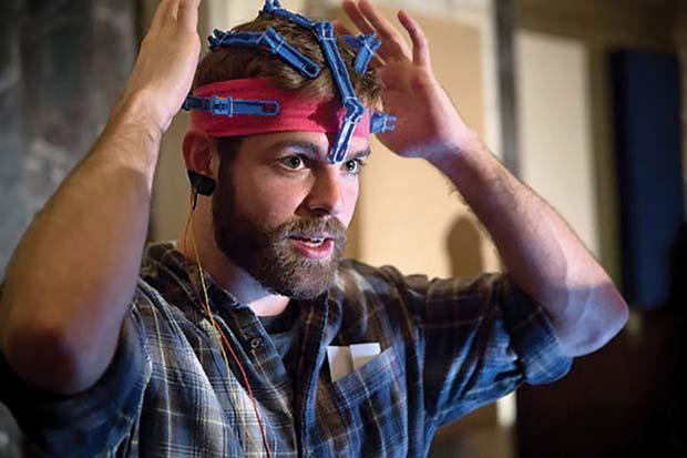 Conor wears an early prototype of the OpenBCI 3D-printable EEG Headset.