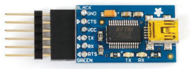 The FTDI Friend, a USB/serial converter. Get it: makershed.com/products/ftdi-friend-v1-0