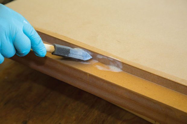 Applying extra coats of sealer to the cut MDF edges