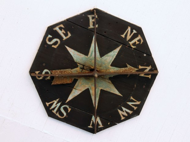 The wind direction is indicated on this compass rose on the ceiling of the front portico.