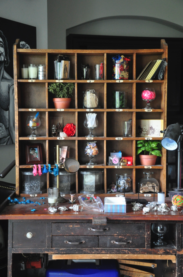 This inspiring workspace is where Rebecca Rose falls into a focused trance as she gathers bits and pieces of toys and trinkets to assemble into teeny, tiny sculptures. Her walls are covered with her own original paintings and the works of other artists.