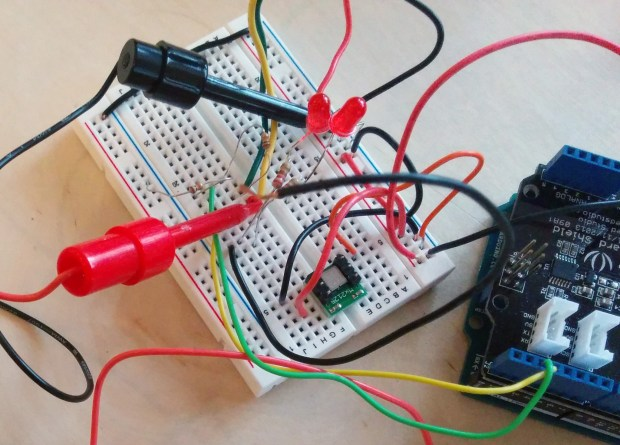 Using oscilloscope probes to test the timing of an Arduino project.