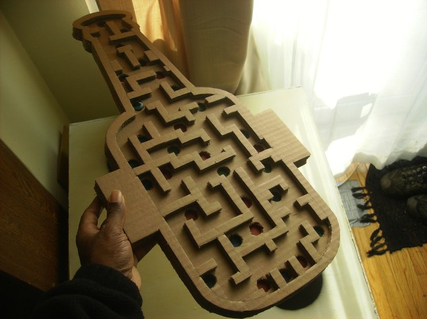 The handheld handmade marble maze game