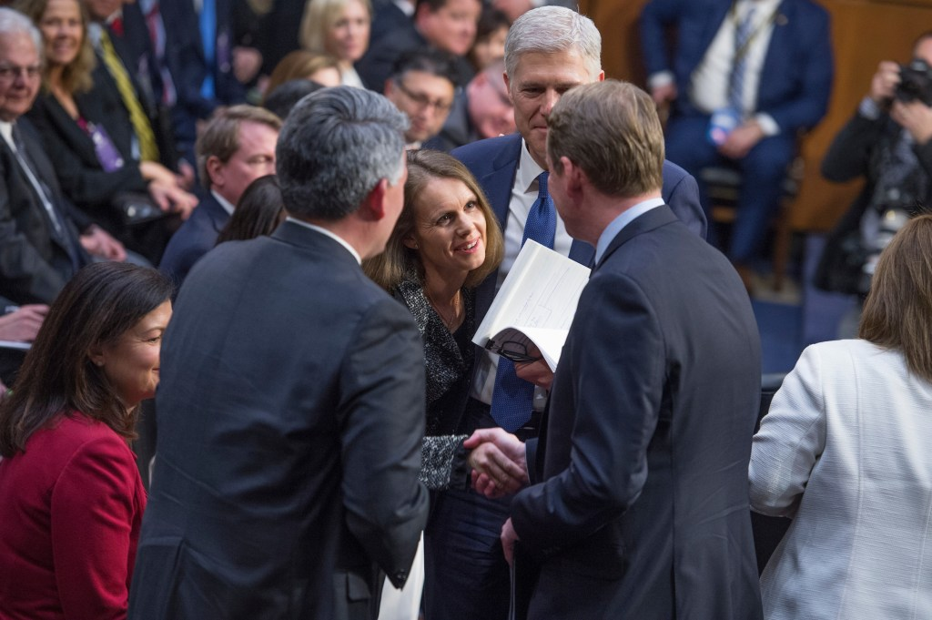 Gorsuch and his wife, Louise, greet Colorado Sens. Cory Gardner, left, and Bennet on Monday. (Tom Williams/CQ Roll Call)