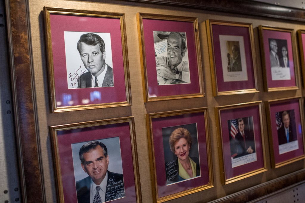Pictures of members of Congress hang in The Monocle Restaurant on Capitol Hill. Top row, from left, former Sens. Robert F. Kennedy and George McGovern. Bottom row, from left, former Rep. Ray LaHood and Sen. Debbie Stabenow. (Tom Williams/CQ Roll Call file photo)