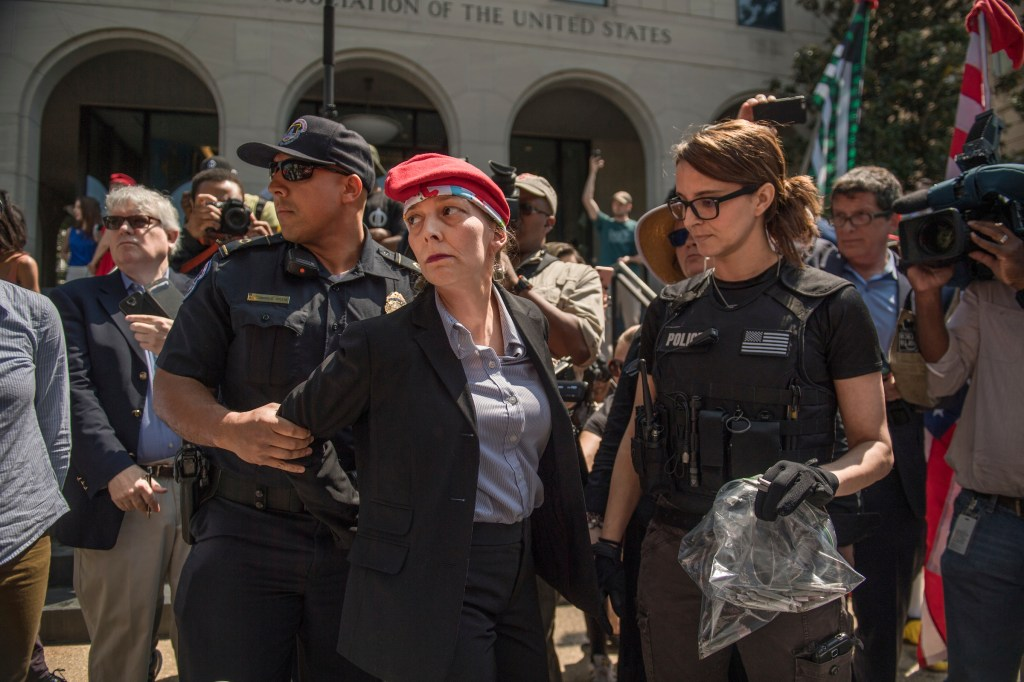 UNITED STATES - APRIL 20: RachelRamone Donlan is arrested after handing out joints during 1st Annual Congressional #JointSession pot giveaway to credentialed Hill staff and the media at Constitution Ave., and First St. NE on April 20, 2017. The joint handout commenced shortly thereafter. The event was held by the DCMJ to call on Congress to reauthorize an amendment that prevents federal legal intervention in the District's marijuana laws. (Photo By Tom Williams/CQ Roll Call)