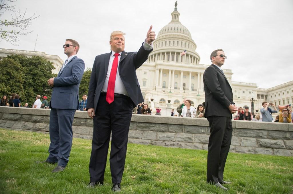 UNITED STATES - APRIL 15: President Donald Trump impersonator Anthony Atamanuik, attends the Tax March rally on the west lawn of the Capitol before a procession to call on Trump to release his tax returns, April 15, 2017. (Photo By Tom Williams/CQ Roll Call)