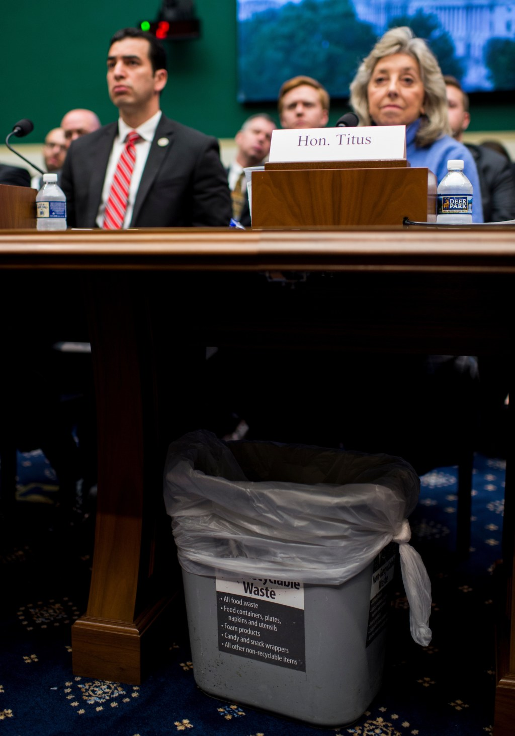UNITED STATES - APRIL 26: A waste basket sits under the witness table as Rep. Ruben Kihuen, D-Nev., and Rep. Dina Titus, D-Nev., prepare to make statements in opposition to using Yucca Mountain as a nuclear waste disposal site during the House Committee on Energy and Commerce Subcommittee on Environment hearing on the