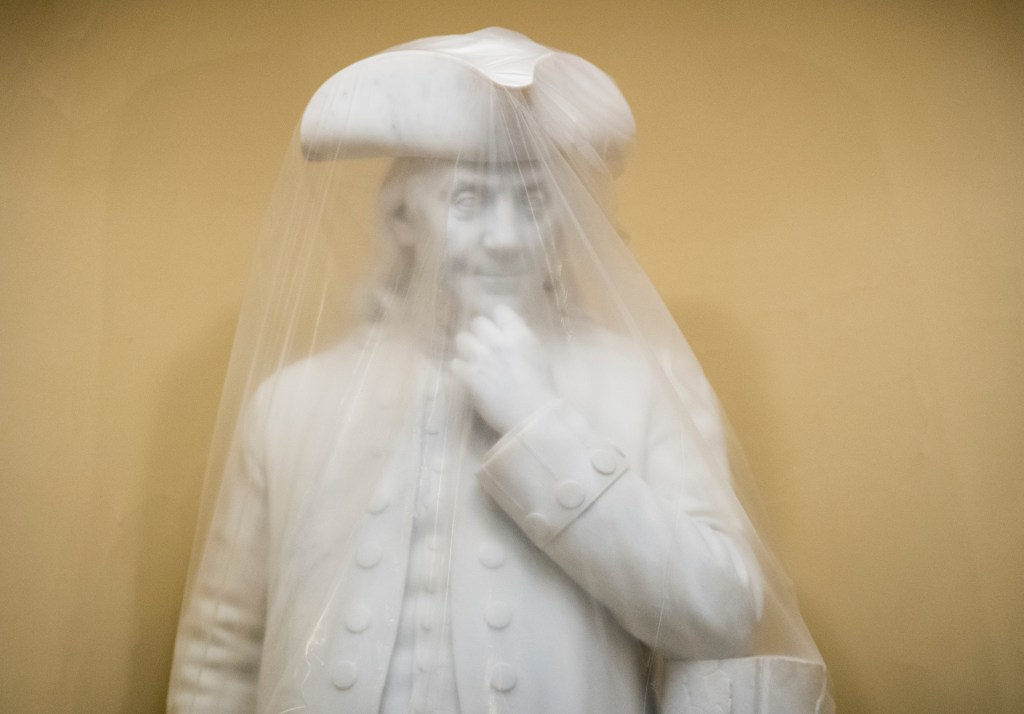 A plastic sheet covers the statue of Ben Franklin in the Capitol on Wednesday, May 10, 2017. (Photo By Bill Clark/CQ Roll Call)