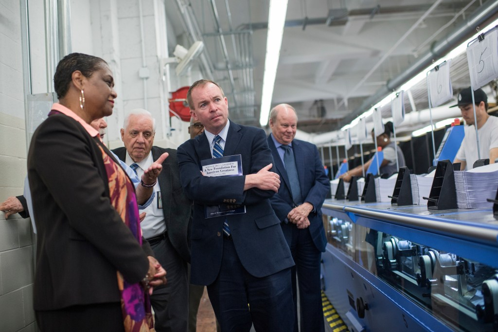 UNITED STATES - MAY 19: OMB Director Mick Mulvaney, center, GPO Director Davita Vance-Cooks, left, and other officials review production of the budget for Fiscal Year 2018 at the Government Publishing Office's plant on North Capitol Street on May 19, 2017. The budget will be released next week. (Photo By Tom Williams/CQ Roll Call)