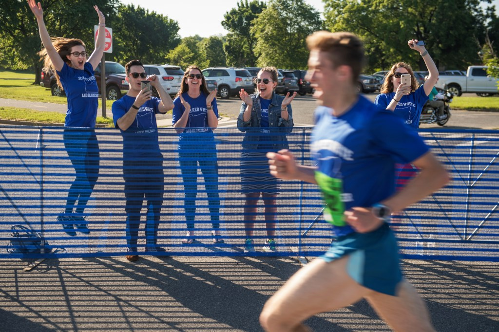 UNITED STATES - MAY 17: Paul Balmer, from the office of Rep. Earl Blumenauer, D-Ore., is cheered on by colleagues before he won the ACLI Capital Challenge 3 Mile Team Race in Anacostia Park, May 17, 2017. (Photo By Tom Williams/CQ Roll Call)