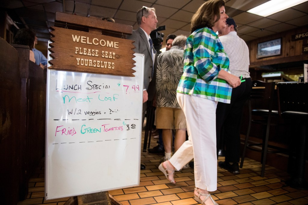 Republican candidate for Georgia's 6th District Karen Handel visits with diners at the Old Hickory House in Tucker, Ga., on the final day of campaigning on Monday. She won the special election held Tuesday. (Bill Clark/CQ Roll Call)