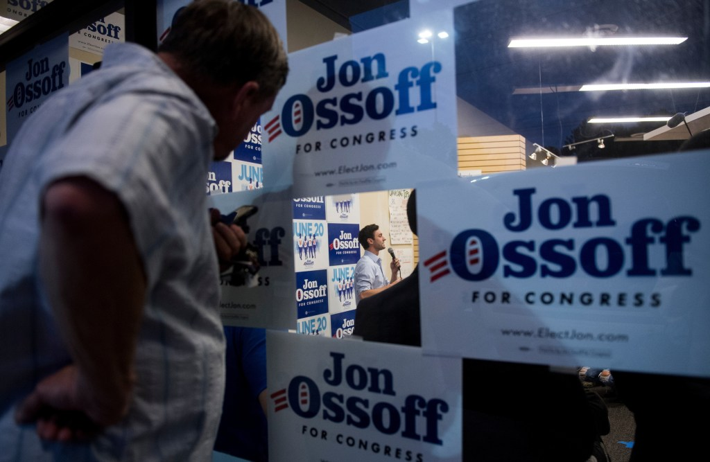 Supporters watch from outside the packed final campaign rally for Ossoff in Roswell, Ga. on Monday night. (Bill Clark/CQ Roll Call)