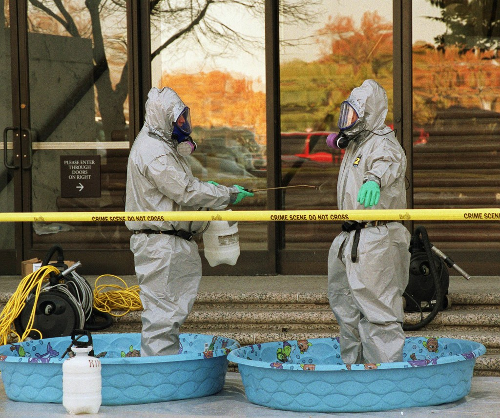 Workers rinse off after exiting the Hart Senate Office Building, which closed for decontamination after an anthrax-laden letter was opened in the office of Senate Majority Leader Tom Daschle, D-S.D. (SCOTT J. FERRELL/CQ Roll Call file photo)