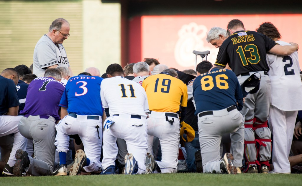 Patrick Conroy, Chaplain of the House of Representatives, left, leads both teams in a moment of prayer before the start of the annual Congressional Baseball Game at Nationals Park in Washington on Thursday, June 15, 2017. (Photo By Bill Clark/CQ Roll Call)