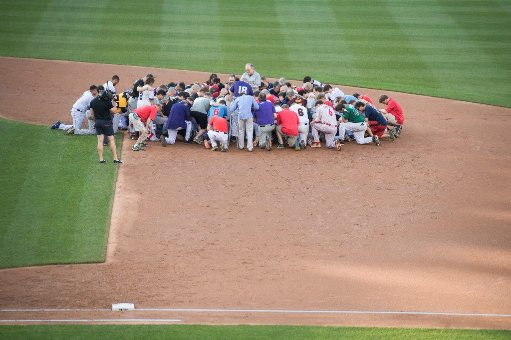 Players pray for the victims of the shooting at the Republican baseball practice before the 56th Congressional Baseball Game at Nationals Park. (Tom Williams/CQ Roll Call)