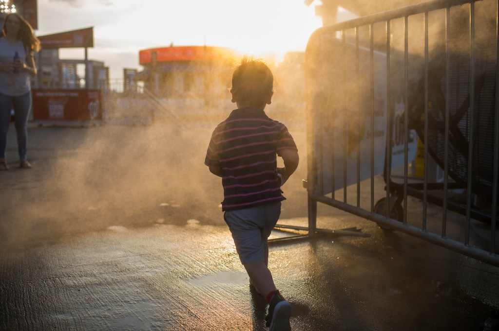 A child runs through a cool zone during the 56th Congressional Baseball Game. (Tom Williams/CQ Roll Call)