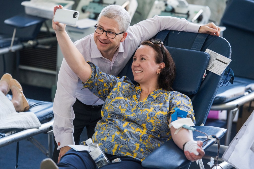 UNITED STATES - JUNE 20: Megan Bel Miller, chief of staff for the personal office of House Majority Whip Steve Scalise, R-La., takes a selfie with Rep. Patrick McHenry, R-N.C., during a blood drive in the foyer of Rayburn Building on June 20, 2017. The drive was held to honor those injured in last week's shooting at the Republican team practice in Alexandria. (Photo By Tom Williams/CQ Roll Call)