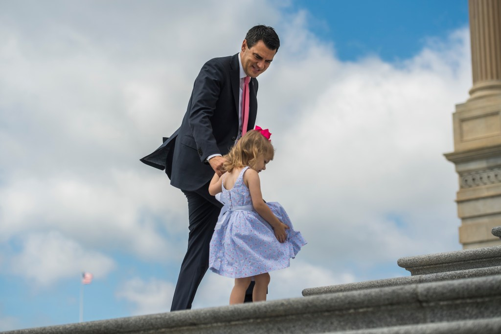 Rep. Kevin Yoder, R-Kan., and his daughter Caroline, 3, climb the House steps of the Capitol after the last votes of the week on Friday. (Tom Williams/CQ Roll Call)