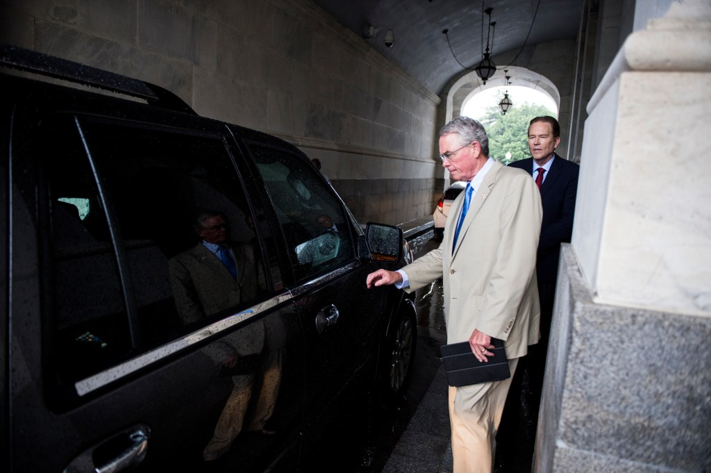 UNITED STATES - JULY 28: Rep. Francis Rooney, R-Fla., gets in a car as Rep. Vern Buchanan, R-Fla., waits for his ride under the carriage entrance during a rain storm following the final votes as Congress leaves town for their summer recess on Friday, July 28, 2017. (Photo By Bill Clark/CQ Roll Call)