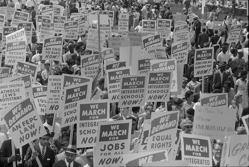 Signs carried by many marchers, during t march. (Photo by Marion S. Trikcoso, courtesy the Library of Congress Prints and Photographs Division.)