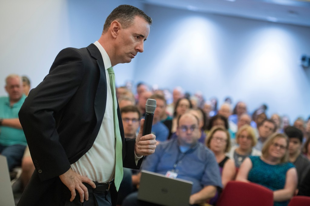 UNITED STATES - AUGUST 22: Rep. Brian Fitzpatrick, R-Pa., talks with guests during a town hall meeting in Bensalem, Pa., on August 22, 2017. (Photo By Tom Williams/CQ Roll Call)