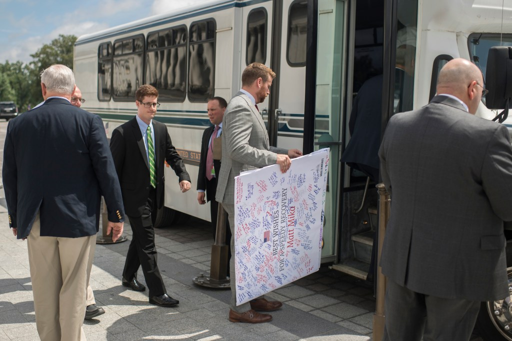 Barth boards a bus along with aides and lawmakers on the East Front of the Capitol to visit Matt Mika in the hospital on June 23. Mika, a lobbyist, was also shot and wounded in the June 14 attack at the Republicans' baseball practice. (Tom Williams/CQ Roll Call File Photo)