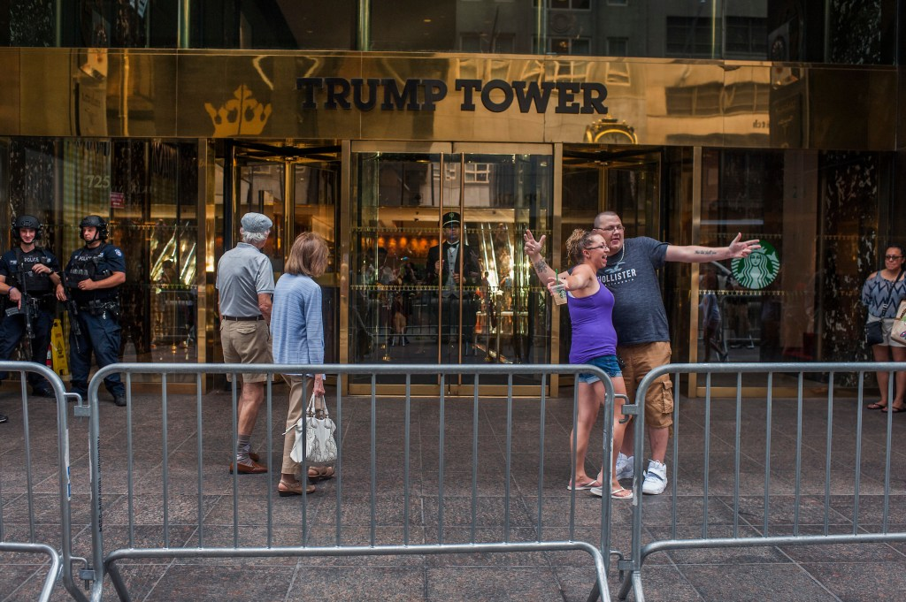 UNITED STATES - AUGUST 05: Visitors pose for pictures outside of Trump Tower on 5th Avenue in New York City on August 5, 2017. (Photo By Tom Williams/CQ Roll Call)