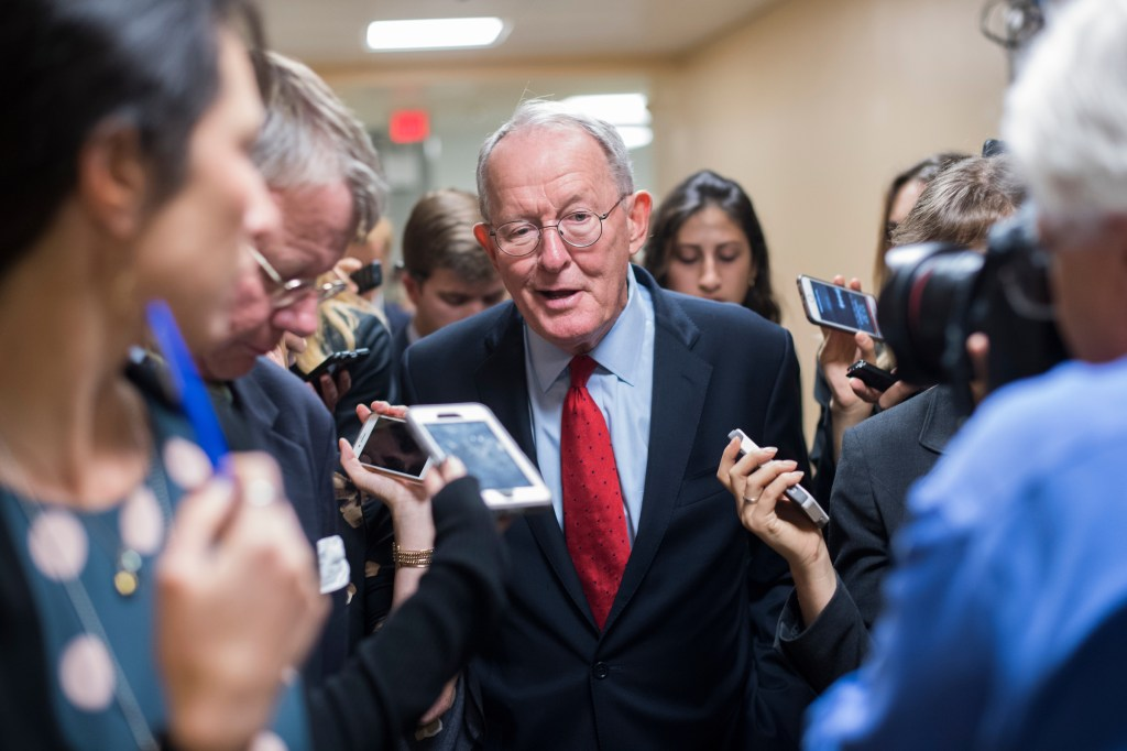 UNITED STATES - SEPTEMBER 19: Sen. Lamar Alexander, R-Tenn., talks with reporters in the basement of the Capitol before the Senate Policy luncheons on September 19, 2017. (Photo By Tom Williams/CQ Roll Call)
