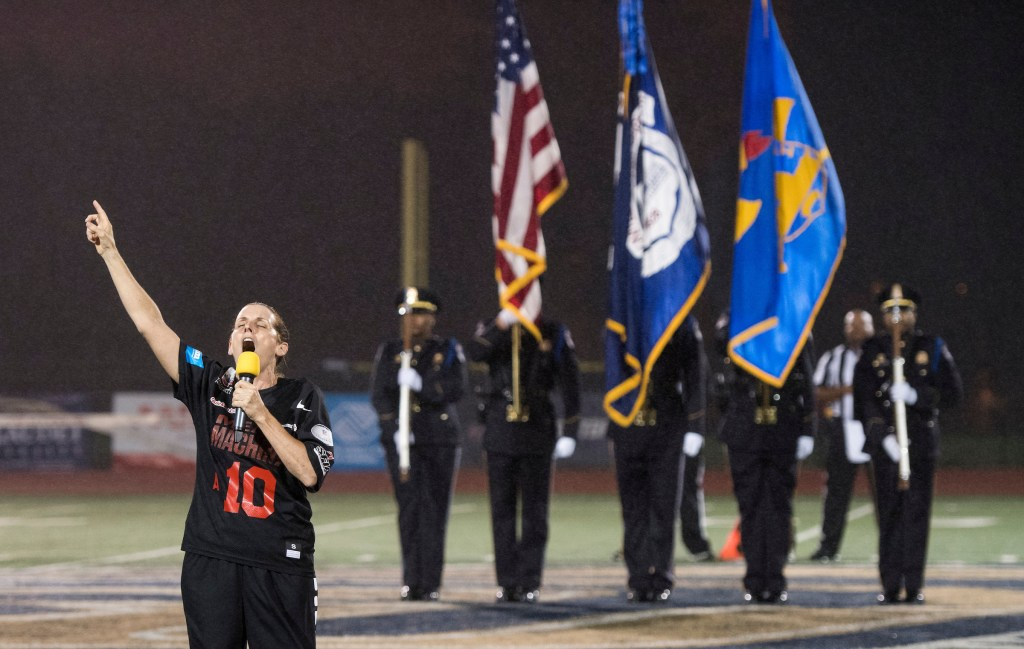 Rep. Martha McSally, R-Ariz., sings the national anthem before the start of the Congressional Football Game on Wednesday. (Bill Clark/Roll Call)