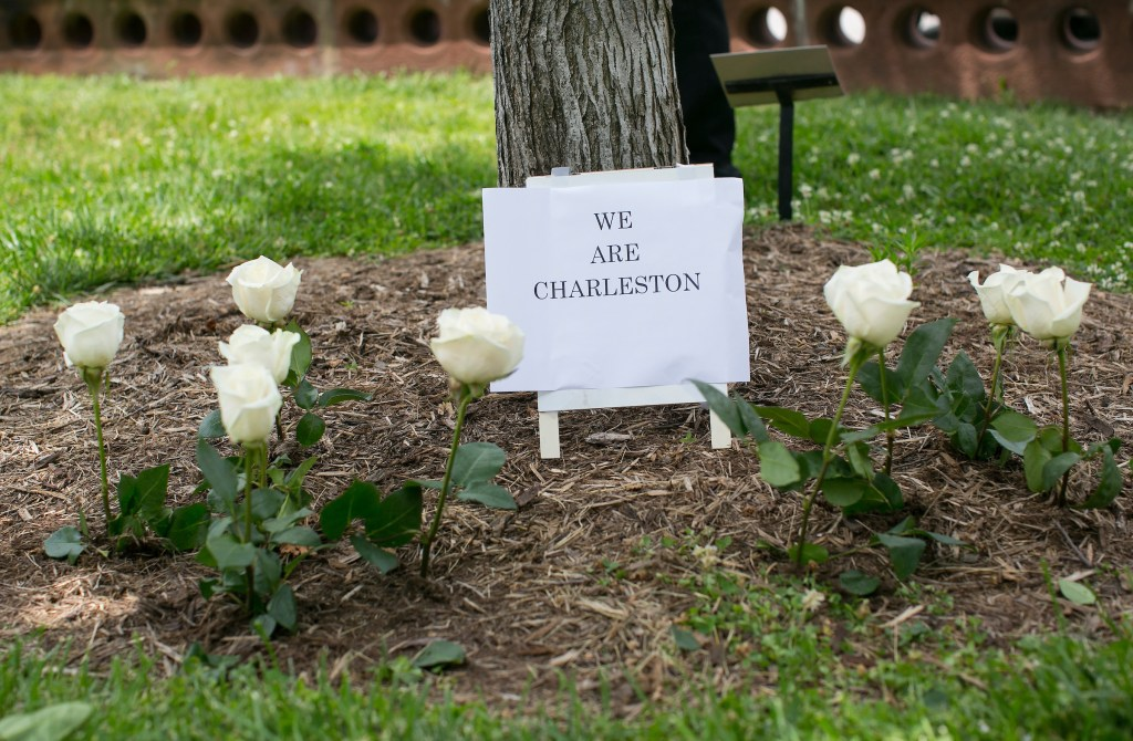 UNITED STATES - JUNE 18 - White roses are placed beside a sign that reads