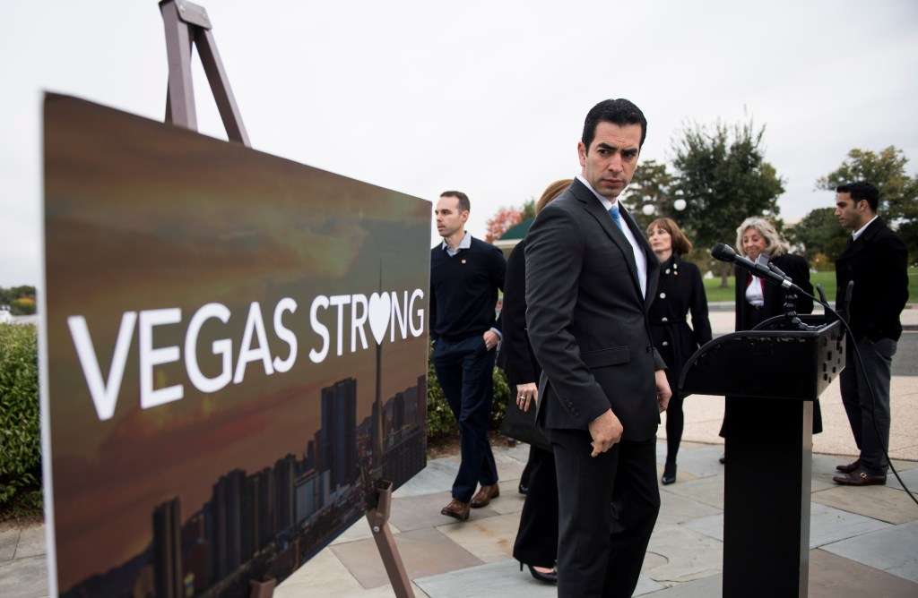 "UNITED STATES - NOVEMBER 1: Rep. Ruben Kihuen, D-Nev., holds a news conference with Las Vegas shooting survivors and Nevada Democrats at the Capitol on Wednesday, Nov. 1, 2017, to call on House Judiciary chairman Bob Goodlatte to hold a hearing and examine the use and legality of ""bump stocks."" (Photo By Bill Clark/CQ Roll Call)"