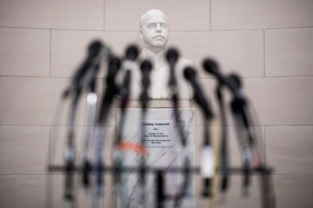 UNITED STATES - NOVEMBER 8: Microphones stand in front of a the bust of former Speaker of the House Nicholas Longworth before the Democrats' press conference on tax reform outside of the House Ways and Means hearing room in the Longworth House Office Building on Wednesday, Nov. 8, 2017. (Photo By Bill Clark/CQ Roll Call)