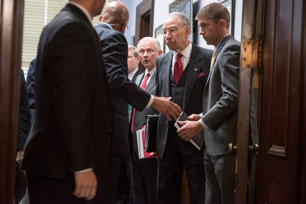 UNITED STATES - JANUARY 10: Sen. Jeff Sessions, R-Ala., center, President-elect Trump's nominee for attorney general, and Chairman Charles Grassley, R-Iowa, second from right, prepare for Sessions' Senate Judiciary Committee confirmation hearing in Russell Building's Kennedy Caucus Room, January 10, 2017. (Photo By Tom Williams/CQ Roll Call)
