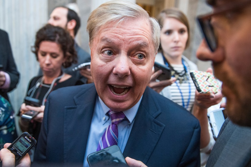 UNITED STATES - SEPTEMBER 19: Sen. Lindsey Graham, R-S.C., talks with reporters in the Capitol after the Senate Policy luncheons on September 19, 2017. (Photo By Tom Williams/CQ Roll Call)