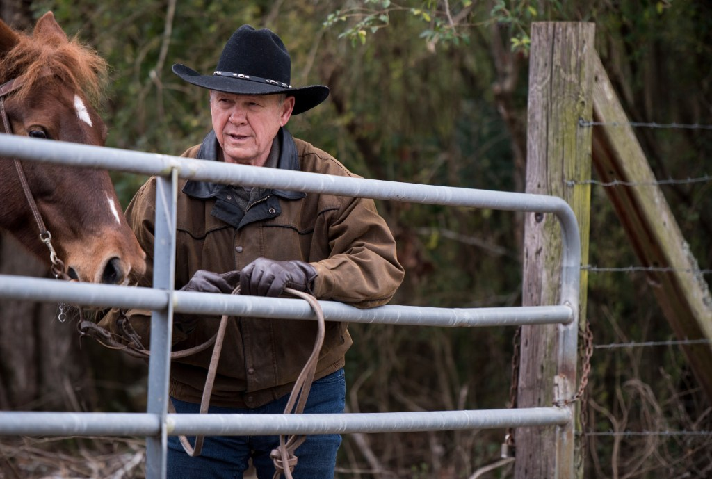 UNITED STATES - DECEMBER 11: Judge Roy Moore ties his horse to a fence as he arrives to vote at the Gallant Volunteer Fire Department in Gallant, Ala., on Tuesday, Dec. 12, 2017. (Photo By Bill Clark/CQ Roll Call)
