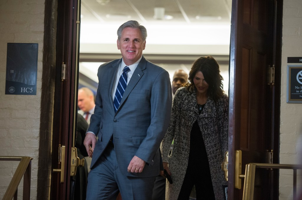 UNITED STATES - NOVEMBER 29: House Majority Leader Kevin McCarthy, R-Calif., and Rep. Kristi Noem, R-S.D., leave the House Republican Conference meeting in the Capitol on November 29, 2017. (Photo By Tom Williams/CQ Roll Call)