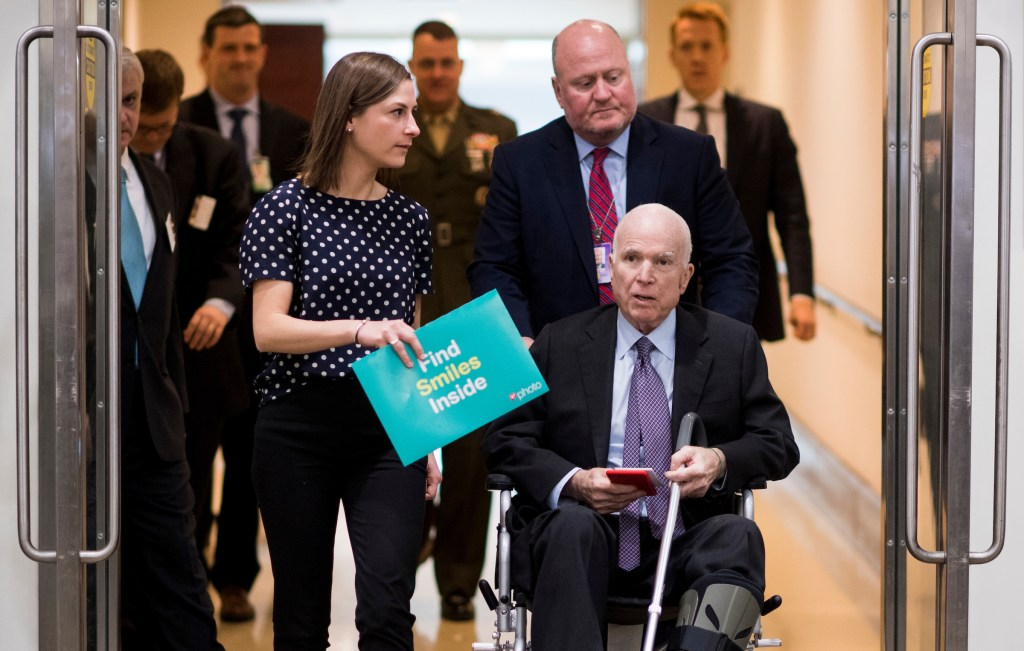 UNITED STATES - DECEMBER 5: Sen. John McCain, R-Ariz., and staff make their way form the Capitol Visitor Center to the Capitol on Tuesday, Dec. 5, 2017. (Photo By Bill Clark/CQ Roll Call)