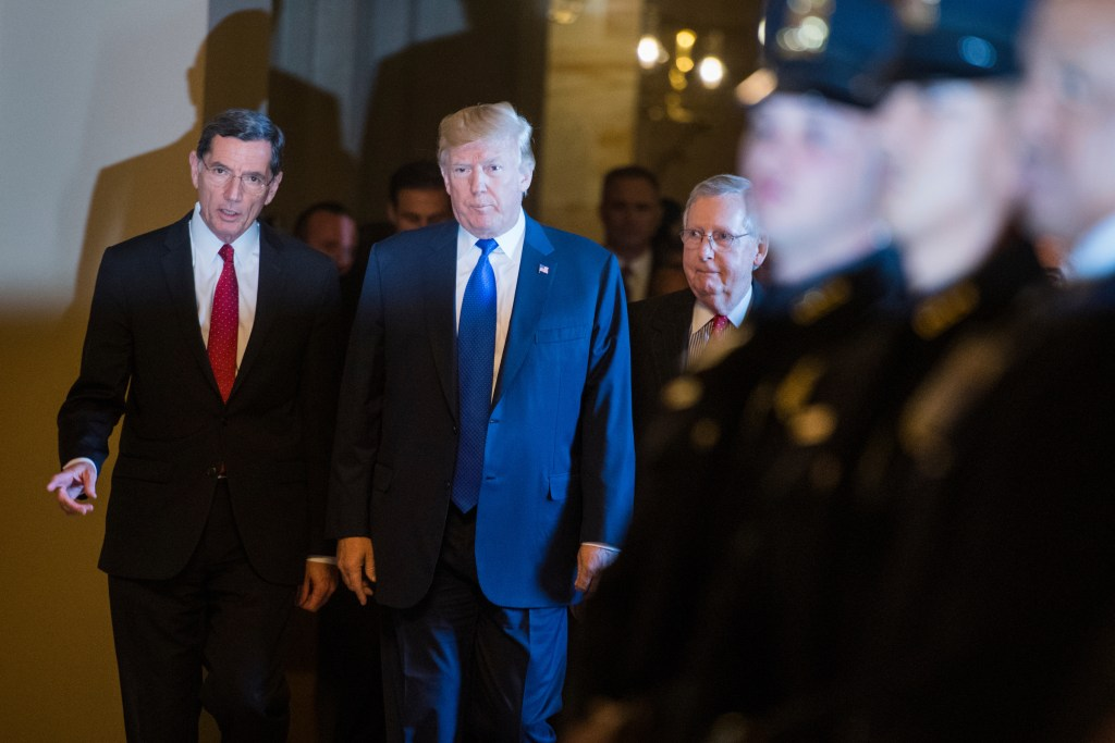UNITED STATES - NOVEMBER 28: President Donald Trump arrives with Sen. John Barrasso, R-Wyo., left, and Senate Majority Leader Mitch McConnell, R-Ky., for the Republican Senate Policy luncheon in the Capitol to discuss the tax reform bill on November 28, 2017. (Photo By Tom Williams/CQ Roll Call)