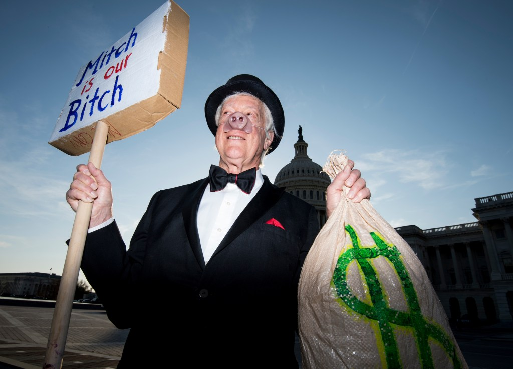 UNITED STATES - NOVEMBER 30: David Barrows, dressed as a billionaire, stands in front of the Capitol as the Senate moves closer to passing its tax reform plan on Thursday, Nov. 30, 2017. (Photo By Bill Clark/CQ Roll Call)