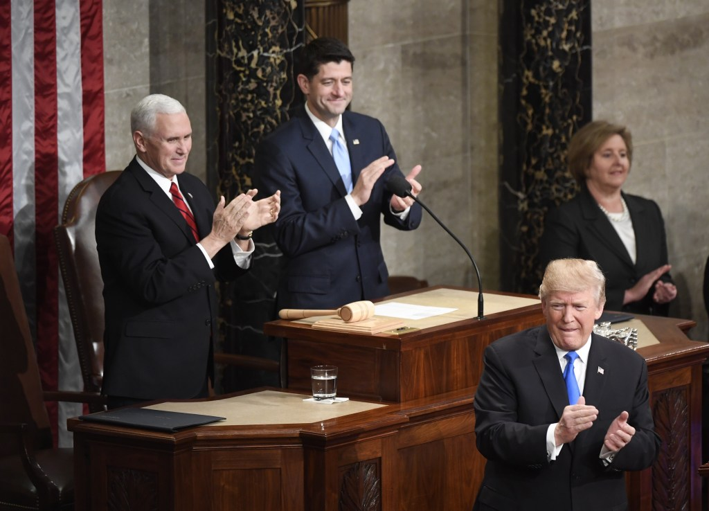 President Donald Trump applauds during his State of the Union address on Tuesday night, as Vice President Mike Pence and Speaker Paul D. Ryan look on. (Bill Clark/CQ Roll Call)