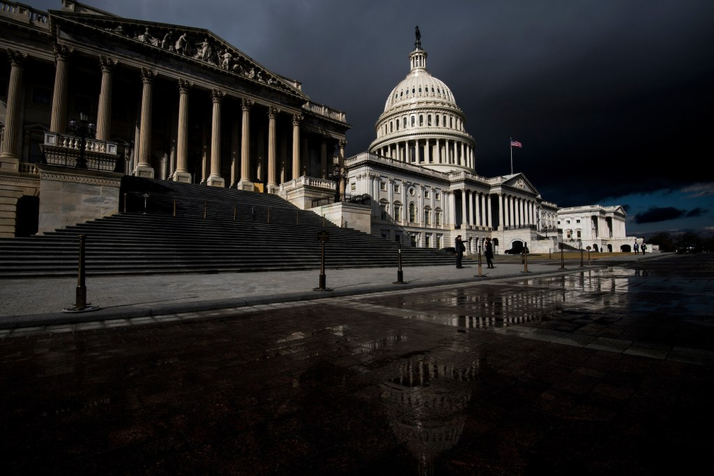 : Storm clouds pass over the dome of the U.S. Capitol building on Tuesday, Jan. 23, 2018. (Bill Clark/CQ Roll Call)