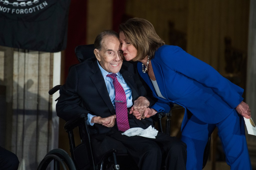 UNITED STATES - JANUARY 17: House Minority Leader Nancy Pelosi, D-Calif., greets former Sen. Bob Dole, R-Kan., during a Congressional Gold Medal ceremony in the Capitol rotunda to honor Dole as a