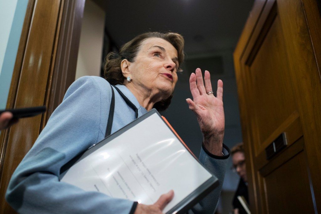 UNITED STATES - JANUARY 11: Sen. Dianne Feinstein, D-Calif., talks with reporters before a Senate Judiciary Committee markup in Dirksen Building on the