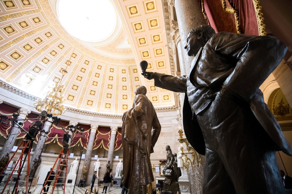 UNITED STATES - JANUARY 30: The statue of Thomas Edison stands in the foreground as techinicians set up lighting in Statuary Hall in preparation for President Donald Trumps' first State of the Union Address on Tuesday, Jan. 30, 2018. (Photo By Bill Clark/CQ Roll Call)