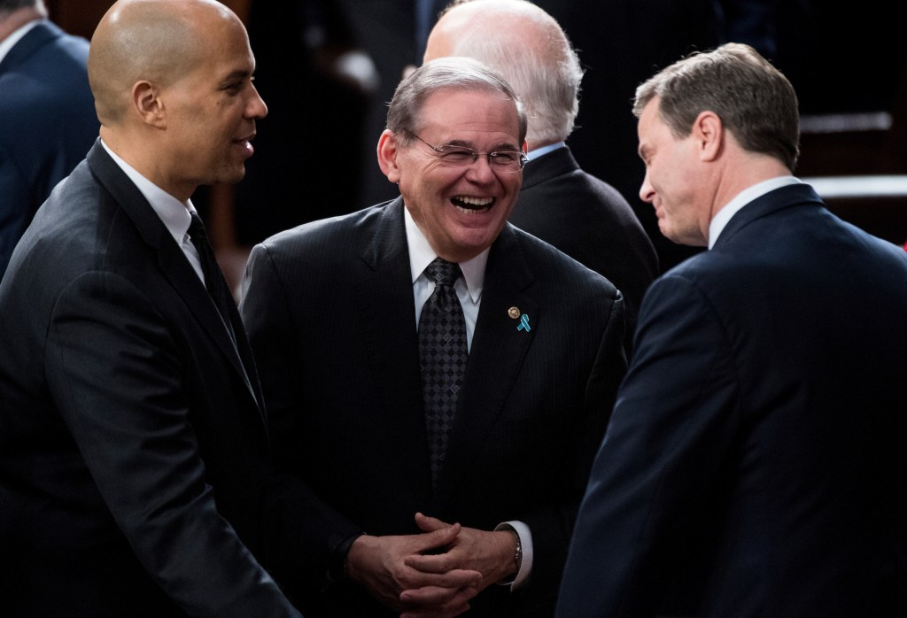 UNITED STATES - JANUARY 30: From left, Sen. Cory Booker, D-N.J., Sen. Bob Menendez, D-N.J., and Rep. Donald Norcross, D-N.J., talk before the start of President Donald Trump's State of the Union Address to the joint session of Congress in the Capitol on Tuesday, Jan. 30, 2018. (Photo By Bill Clark/CQ Roll Call)